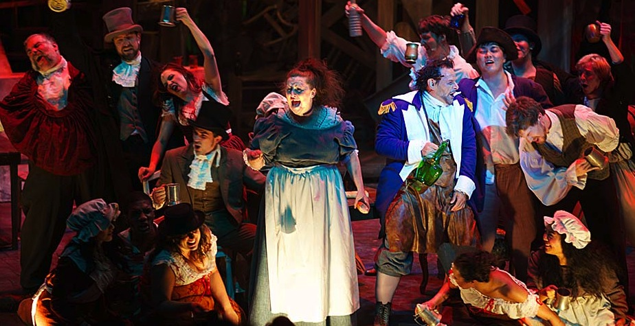 """SUZI NOMINEES Marcie Millard and Anthony P. Rodriguez (center) lead the Aurora Theatre cast of """"Les Miserables"""" in the raucous """"Master of the House."""" Photo: Chris Bartelski"""