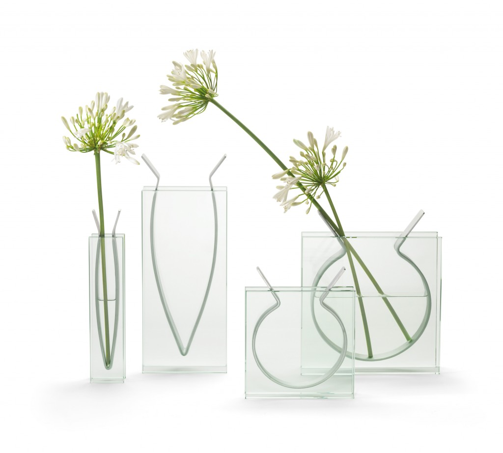 A metal band, curved to hold water and flowers, is suspended securely between parallel walls of glass in this vase, available at the High Museum gift shop.