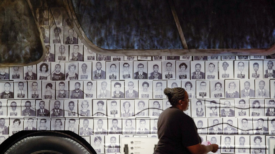 IN THIS EXHIBIT mug shots of Freedom Riders are affixed to the side of a model bus.