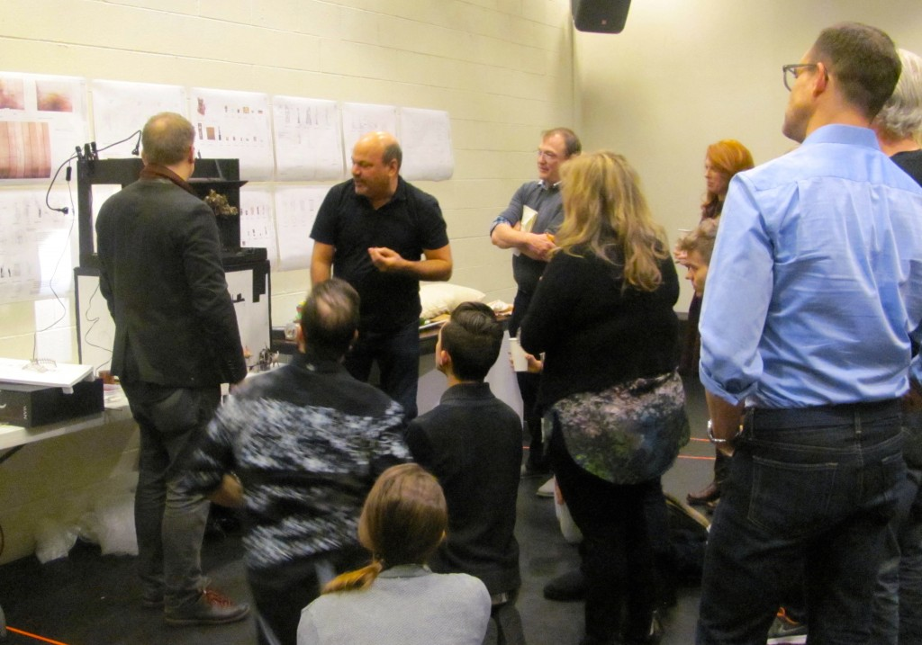Director Casey Nicholaw (center) presents the set design to the cast on the first day of rehearsals.