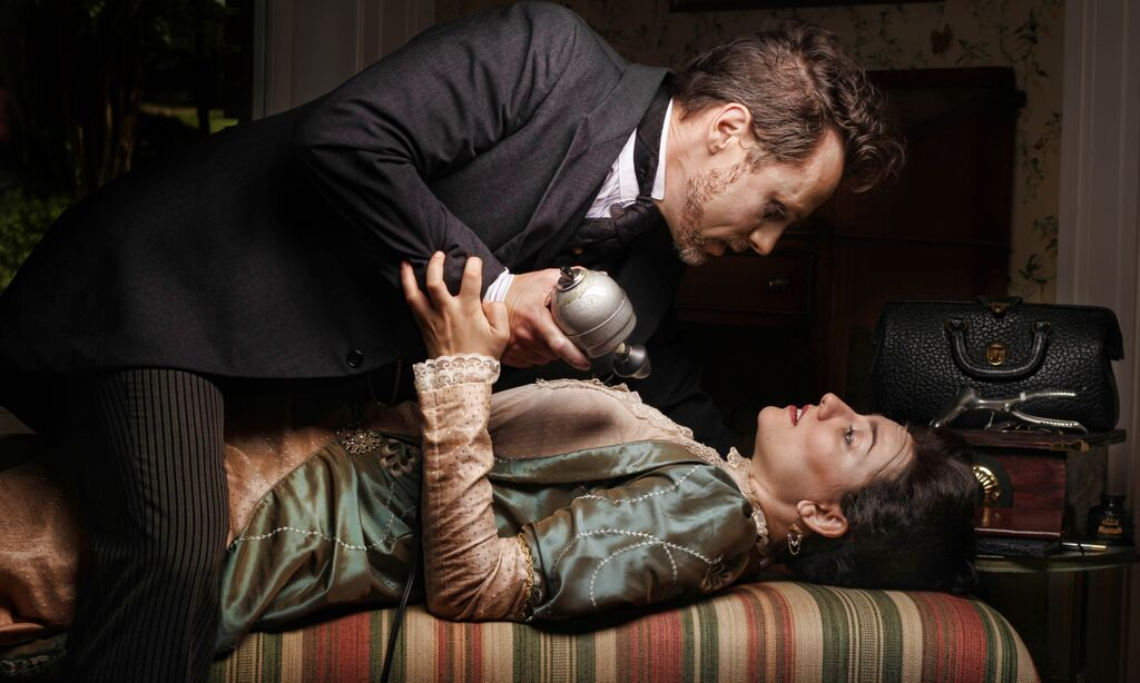 May, as the good doctor, with his onstage wife (Bryn Striepe). Photo: BreeAnne Clowdus