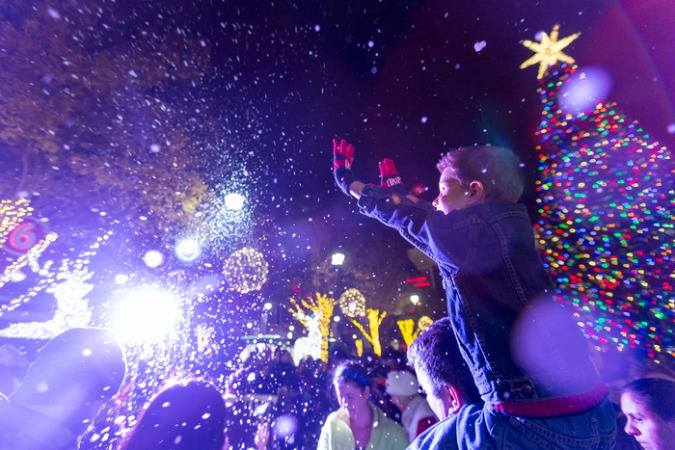 It's snowing amid the light and happy faces at Atlantic Station's annual tree lighting. Photo: Liana Moran/The Wilbert Group