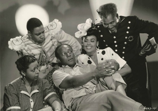 "Ethel Waters (far left) in a scene from the 1943 movie musical ""Cabin in the Ssky,"" with Eddie ""Rochester""' Anderson, Lena Horne and Rex Ingram."