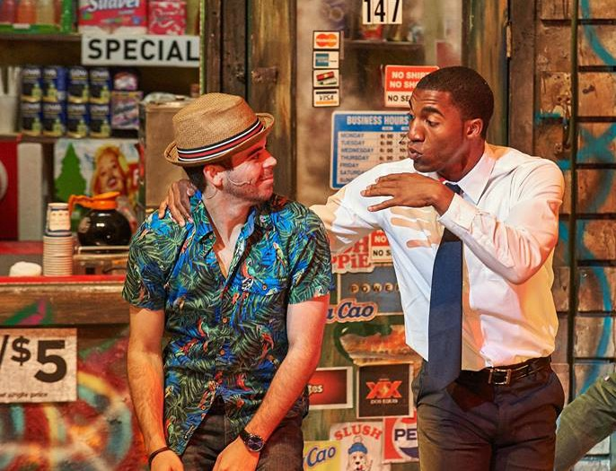 Usnavi (Diego Klock-Perez) and Benny (Garrett Turner) catch up at Usnavi's corner bodega. Photo: Chris Bartelski