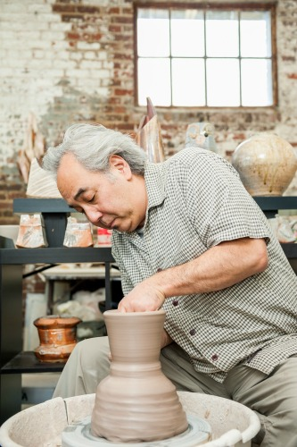 Ceramic artist Akira Satake does his thing at CURVE. Photo: ExploreAsheville.com