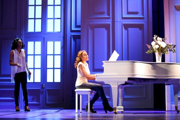 The stage musical increases the role of Nicki Marron (Jasmin Richardson, left), the pop superstar's sister. Deborah Cox, as Rachel, is at the piano. Photo: Joan Marcus