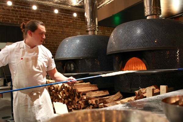 Double Zero executive chef Edwin Molina, works the massive bricks ovens.