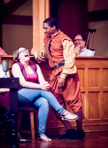 "As often happens at the Blackfriars Playhouse, Kyle Powell (as Sampson in ""Romeo & Juliet"") lets a theatergoer in on the joke. Photo: Tommy Thompson."