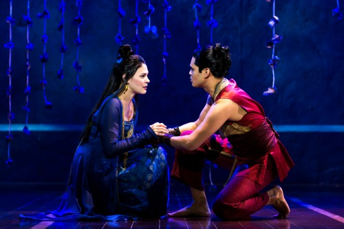 The slave girl Tuptim (Manna Nichols) and her Burmese love Lun Tha (Kavin Panmeechao) kiss in a shadow. Photo: Matthew Murphy