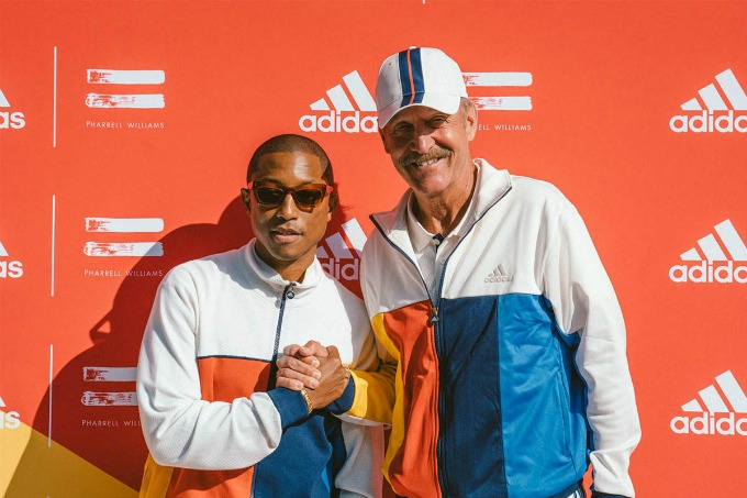 Pharrell Williams (left) in his adidas gear at the US Open with retired tennis champ Stan Smith.